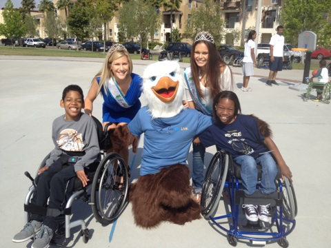 photo of Miss Mission Beach and 1st Princess with 2 of ASRA's junior athletes.
